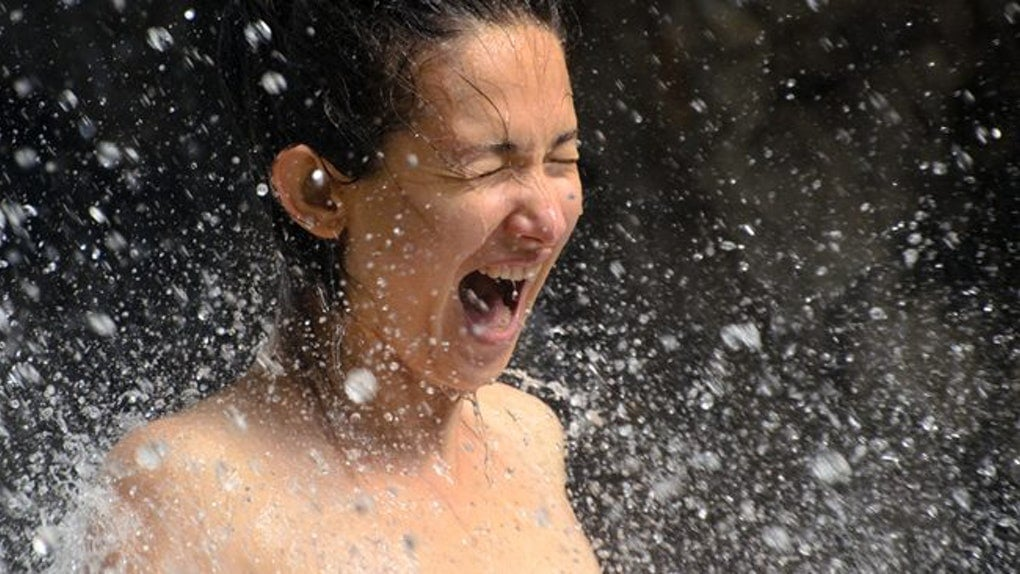suprised woman spashed with water at omgloh.com